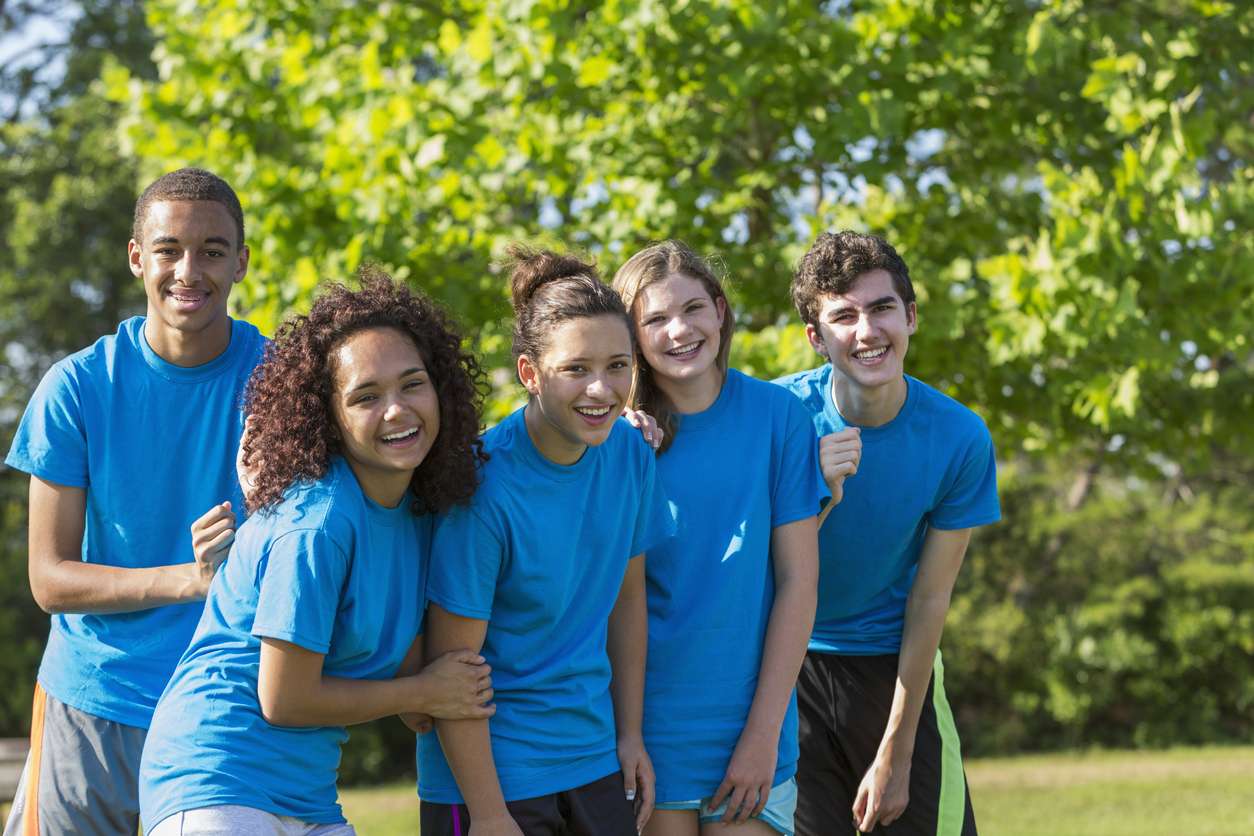 Group of teens in matching shirts participating in summer program